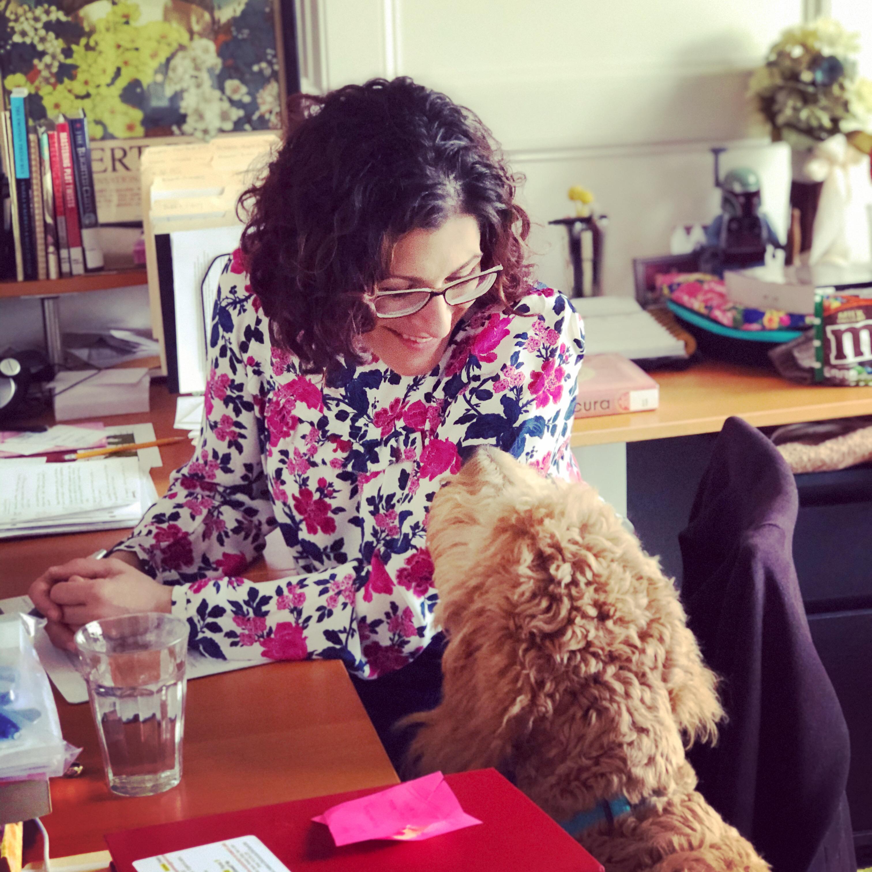 Hallie listens to her golden doodle, Bruno.