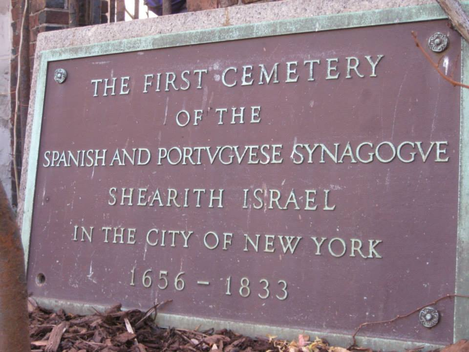 A plaque that reads: The first cemetery of the Spanish and Portuguese synagogue, Shearith Israel, in the city of New York. 1656-1833