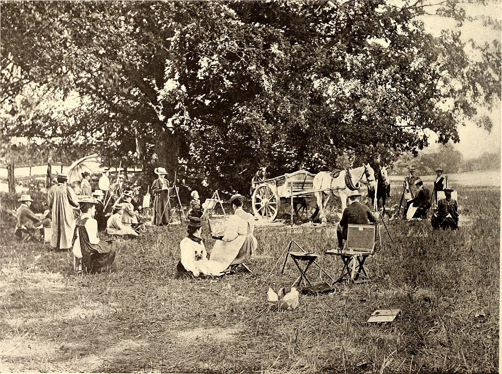 Ladies sitting beside a large tree painting or looking at the scenery. A spring in the background. A horse and cart in front of the tree. Photograph.