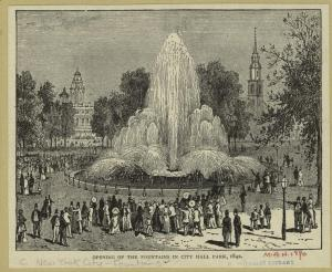 People celebrating around a 50 foot fountain.