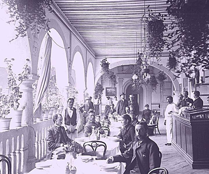 Eating at a restaurant on the verandah, 19th century